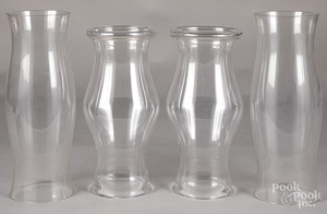 Two pairs of glass hurricane shades
