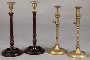 Pair of brass and carved mahogany candlesticks
