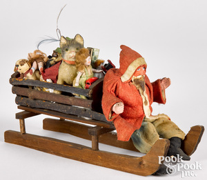 German Father Christmas in a sleigh of toys