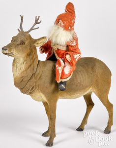 Father Christmas on a reindeer candy container