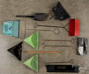 Seven tin advertising dust pans