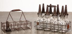 Eight Duraglass motor oil jars in wire carrier