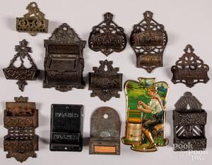 Twelve cast iron and tin wall mount match safes