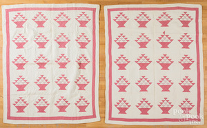 Pair of pink and white basket quilts
