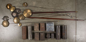 Antique clock weights and pendulums.