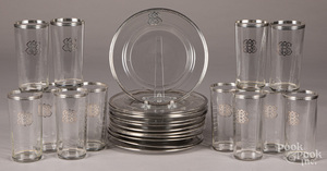 Twelve sterling silver mounted plates and glasses