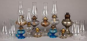 Ten glass fluid lamps.