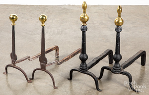 Two pairs of brass and iron andirons