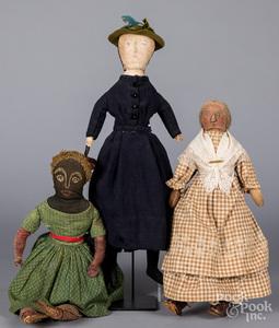 Three early folk art cloth dolls