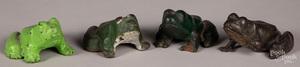 Four cast iron frog doorstops.