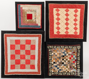 Four framed doll quilts