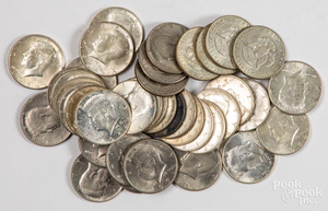 Twenty-two 1964 Kennedy half dollars, etc.