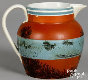 Mocha pitcher with two-way seaweed decoration