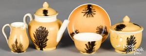 Miniature mocha teawares, with seaweed decoration
