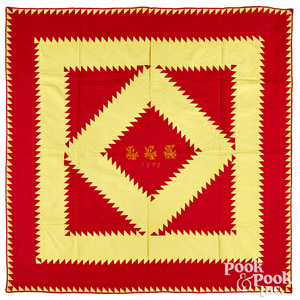 Vibrant red and yellow sawtooth diamond quilt