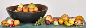 Turned and painted bowl, together with stone fruit