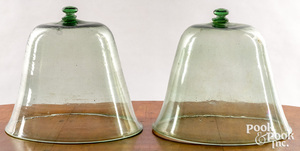 Two light green glass bell jars