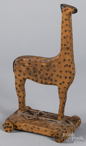 Painted pine giraffe pull toy, 20th c.