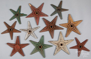 Eleven painted iron architectural stars, 19th c.