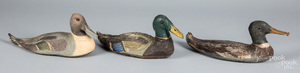 Three painted canvas duck decoys, 20th c.
