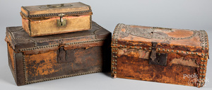 Three hide covered boxes