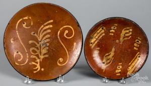 Two slip decorated redware plates
