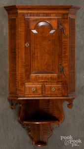 Bench made tiger maple hanging corner cupboard