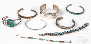 Eight Native American silver and copper bracelets