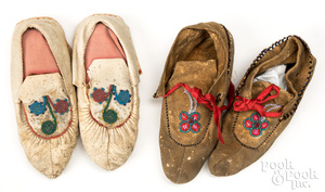 Two pairs of children's Woodland Indian moccasins