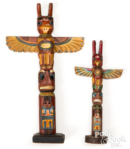 Two Pacific Northwest Coast carved totem poles