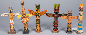 Six Northwest Coast Indian carved totem poles