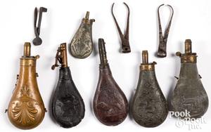 Eight powder flasks