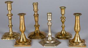 Five brass candlesticks, and a Paktong stick