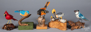 Five carved and painted birds
