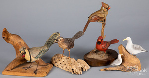 Four carved and painted bird groups
