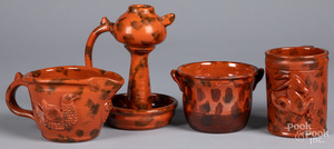 Four pieces of Seagreaves redware