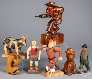 Seven carved and painted folk art figures