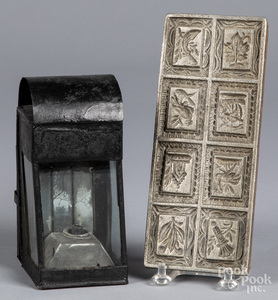Tin lantern, together with a lead food mold