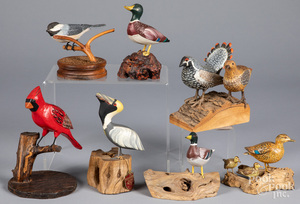 Group of carved and painted birds
