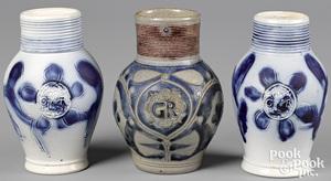 Two Staffordshire salt glaze stoneware GR jugs