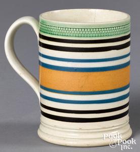 Mocha mug, with brown, blue, and tan bands
