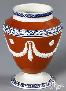 Mocha urn, with relief swags on an umber ground