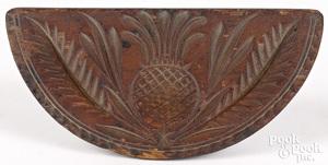 Carved pine half round butterprint, 19th c.