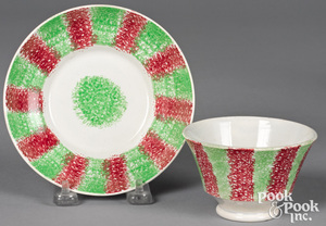 Green and red rainbow spatter cup and saucer,