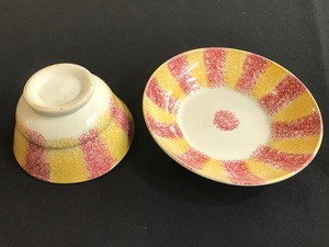 Red and yellow rainbow spatter cup and saucer