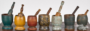 Collection of seven painted mortar and pestles, 19