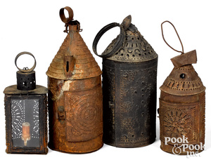 Four punched tin lanterns, 19th c., tallest - 15