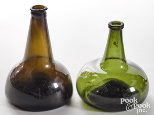 Two olive glass squat bottles, late 18th c.