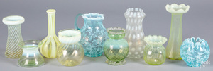 Group of opalescent vaseline and blue glass vases