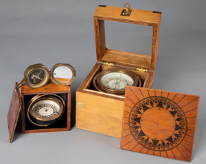 Two gimbal mounted brass ships compass